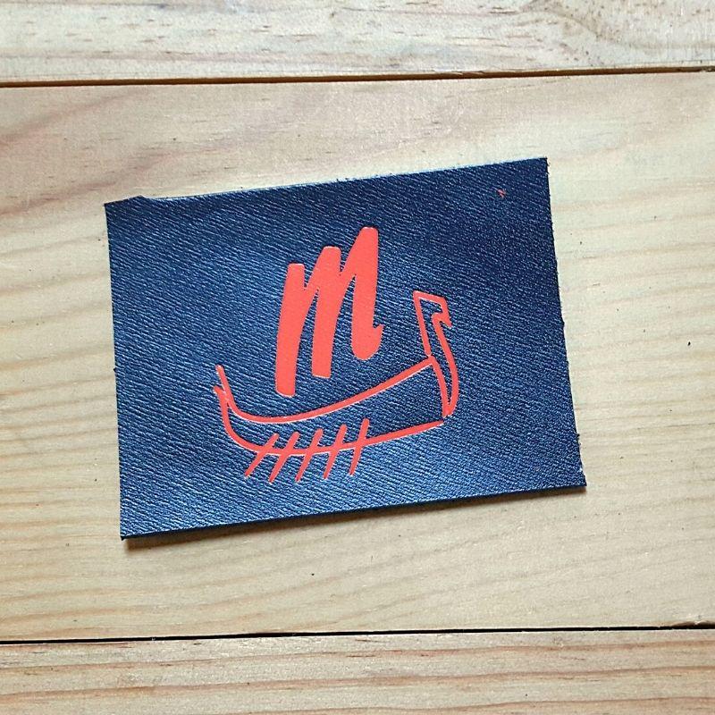 Logo drakkar orange 4cm